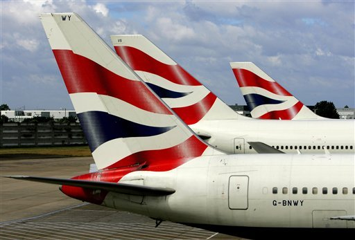 British Airways planes are seen parked at Heathrow airport, London, in this June 22, 2006 file photo. (AP Photo/Kirsty Wigglesworth, File)