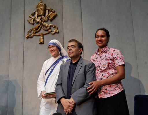 From left, Sr. Mary Prema Pierick, Superior General of the Missionaries of Charity, Marcilio Andrino, center and his wife Fernanda Nascimento Rocha.