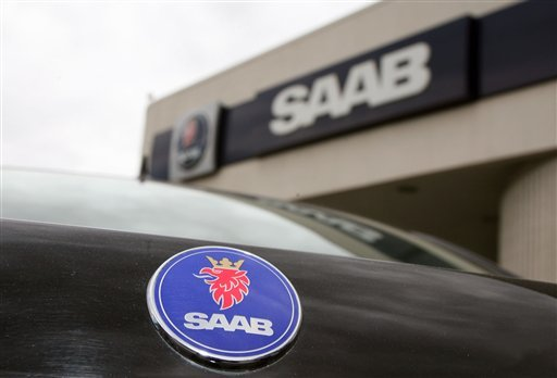 FILE - In this April 11, 2006 file photo, the logo of the Swedish automobile manufacturer Saab adorns the hood of a sedan outside a south Denver Saab dealership. (AP Photo/David Zalubowski, File)