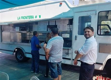 """A Hispanic Donald Trump supporter's assertion that without Trump there could one day be """"taco trucks on every corner"""" in the U.S. stirred ridicule, not to mention hunger, across the internet Friday. (Monica Sandschafer via AP)"""