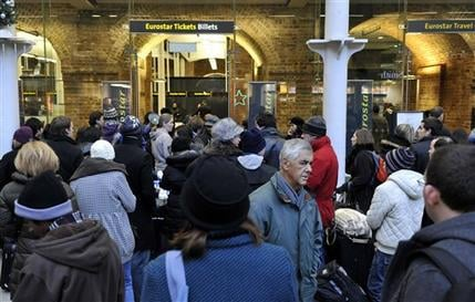 Passengers wait at St Pancras Station in London after delays to the Eurostar train services, Saturday Dec. 19, 2009. (AP Photo/PA, Tim Ireland)