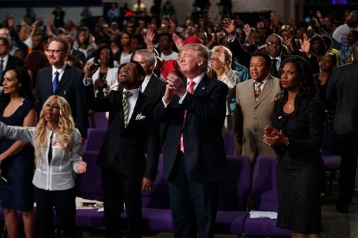 Republican presidential candidate Donald Trump shown during a church service at Great Faith Ministries.
