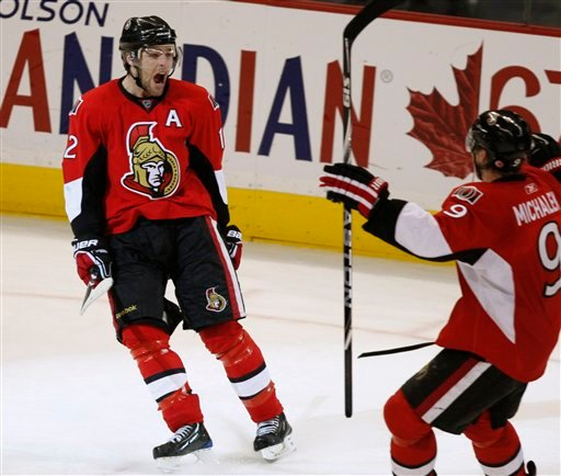 Ottawa Senators' Mike Fisher, left, celebrates his winning goal with teammate Milan Michalek, of Russia, against the Washington Capitals during NHL overtime in Ottawa Monday Nov. 23, 2009.