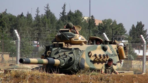 "A Turkish army tank stationed near the Syrian border, in Suruc, Turkey, Saturday, Sept. 3, 2016. Turkey's state-run news agency says Turkish tanks have entered Syria's Cobanbey district northeast of Aleppo in a ""new phase"" of the Euphrates Shield operatio"