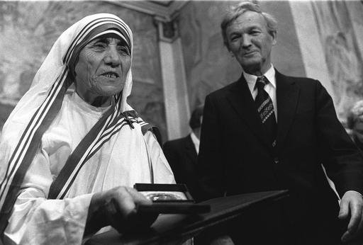 In this Dec. 10, 1979 file photo, Mother Teresa receives the Nobel Peace Prize during a ceremony at Oslo University. At right is the Chairman of the Norwegian Nobel Committee, Professor John Sanness. With Sunday, Sept. 4, 2016 making the canonization of M