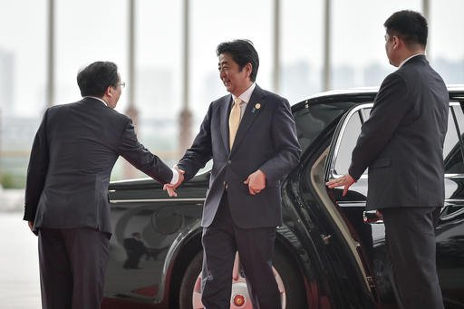 Japan's Prime Minister Shinzo Abe arrives at the G-20 summit in Hangzhou, China, Sunday, Sept. 4, 2016. (Etienne Oliveau/Pool Photo via AP)