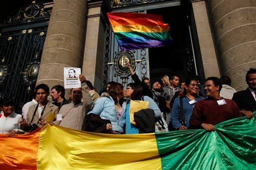 Gay rights activists celebrate the legalization of same-sex marriage in front of Mexico City's local assembly, Monday, Dec. 21, 2009. AP Photo/Alexandre Meneghini)