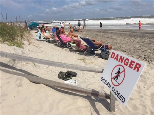 People sit at the beach in Ocean City, N.J., on Sunday, Sept. 4, 2016. (Viviana Pernot /The Press of Atlantic City via AP)