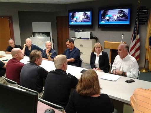 New Jersey Lt. Governor Kim Guadagno, second from right, meets with New Jersey DEP Commissioner Bob Martin, right, and Congressman Frank LoBiondo Sept. 4, 2016, at the Cape May County Office of Emergency.(Michael Miller /The Press of Atlantic City via AP)
