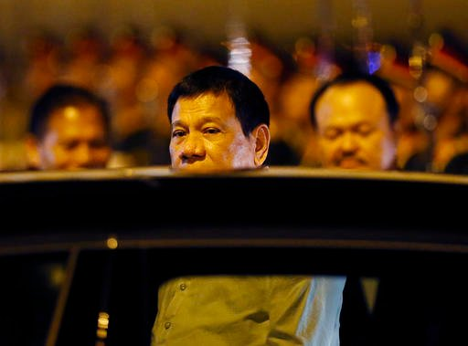 Philippine President Rodrigo Duterte boards his limousine upon arrival in Vientiane, Laos to attend the 28th and 29th ASEAN Summits and other related summits Monday, Sept. 5, 2016 in Vientiane, Laos. Laos is this year's host of the annual regional meeting