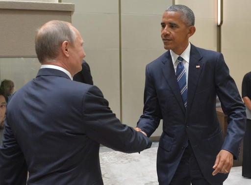 Russian President Vladimir Putin, left, shakes hands with U.S. President Barack Obama in Hangzhou in eastern China's Zhejiang province, Monday, Sept. 5, 2016. (Alexei Druzhinin, Sputnik, Kremlin Pool Photo via AP)