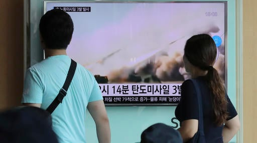 People watch a TV news program reporting about North Korea's missile launch, at the Seoul Train Station in Seoul, South Korea, Monday, Sept. 5, 2016. North Korea fired three ballistic missiles off its east coast Monday, South Korea's military said, in a s