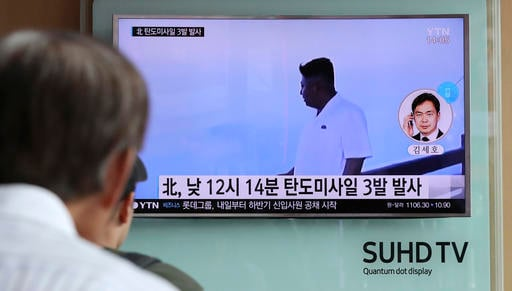A man watches a TV news program showing a file image of North Korean leader Kim Jong Un while reporting about the North's missile launch, at the Seoul Train Station in Seoul, South Korea, Monday, Sept. 5, 2016. North Korea fired three ballistic missiles o