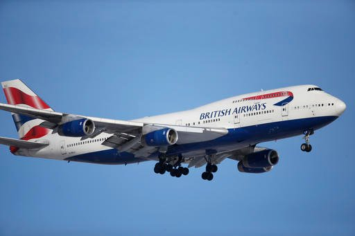 British Airways plane lands on a runway at Denver International Airport.