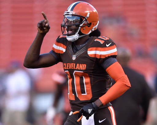 In this Thursday, Sept. 1, 2016 file photo, Cleveland Browns quarterback Robert Griffin III runs the field before an NFL preseason football game against the Chicago Bears, in Cleveland.