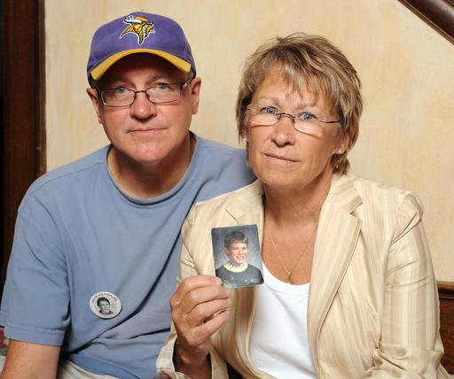 In this Aug. 28, 2009, file photo, Patty and Jerry Wetterling show a photo of their son Jacob Wetterling, who was abducted in October of 1989 in St. Joseph, Minn and is still missing, in Minneapolis. Patty Wetterling said Saturday, Sept. 3, 2016 that his