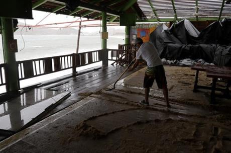 The U.S. National Hurricane Center says Newton's winds Tuesday morning were around 90 mph (150 kph) and the storm is expected to still be a hurricane when it makes its second landfall on the northwest coast of mainland Mexico early Wednesday. (AP Photo/Ed