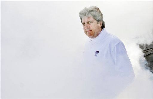 FILE - In this Nov. 29, 2008 file photo, Texas Tech head football coach Mike Leach walks through dry ice smoke before the start of an NCAA college football game against Baylor in Lubbock, Texas.