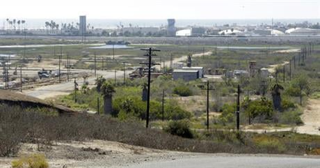 The California Coastal Commission will hold a hearing in Newport Beach on Wednesday, Sept. 7, 2016, on the plan to build 895 homes, a 75-room hotel and retail complex on the 401-acre site long used for oil drilling. (AP Photo/Nick Ut, File)