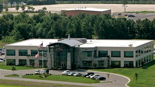 FILE - In a Monday, July 21, 2008 file photo, Blackwater Worldwide's headquarters is seen in Moyock, N.C. U.S. District Judge Ricardo Urbina dismissed all charges against five Blackwater Worldwide security guards charged in a deadly 2007 Baghdad shooting,