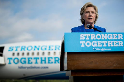Democratic presidential candidate Hillary Clinton speaks to members of the media before boarding her campaign plane at Westchester County Airport in White Plains, N.Y.