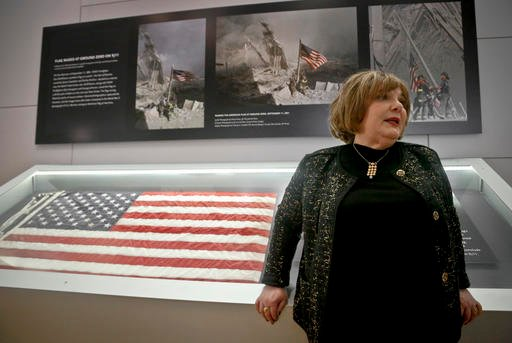 Shirley Dreifus, the original owner of the American flag, left, that firefighters hoisted at ground zero in the hours after the 9/11 terror attacks, speaks during an interview at the Sept. 11 museum, Thursday Sept. 8, 2016, in New York. After disappearing