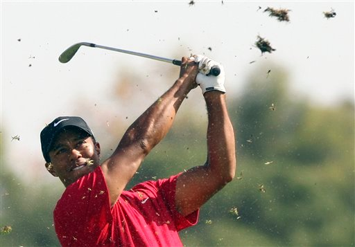 FILE - In this Nov. 15, 2009, file photo, Tiger Woods of the United States, hits a shot on the 18th in Melbourne, Australia, Sunday, Nov. 15, 2009 during the Australian Masters golf tournament at Kingston Heath.