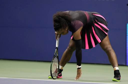 Serena Williams catches her balance after a serve from Karolina Pliskova, of the Czech Republic.