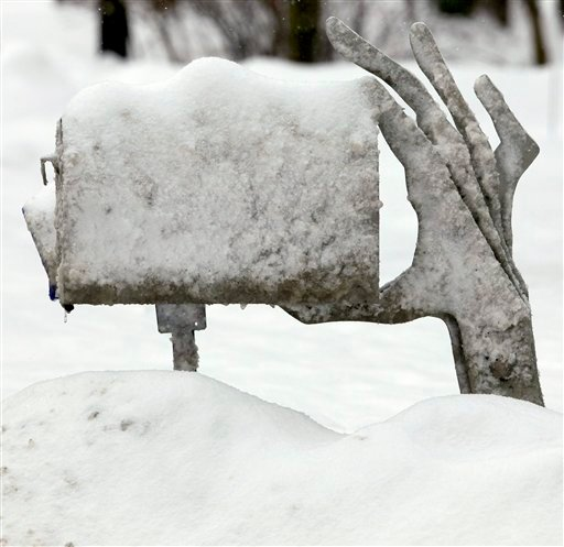 A mailbox with a unique post sticks up from a snow bank at the end of a Moreland Hills, Ohio driveway on Tuesday, Jan. 5, 2010. (AP Photo/Amy Sancetta)