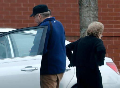 John Hinckley Jr., left, gets into his mother's car in front of a recreation center in Williamsburg, Va.
