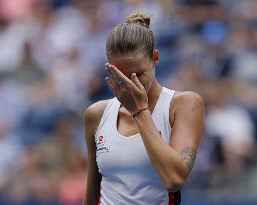 Karolina Pliskova, of the Czech Republic, puts her hand to her face during her match with Angelique Kerber.
