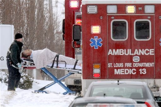 A member of the St. Louis Fire Department pushes a person on a stretcher to a waiting ambulance outside ABB Inc.,Thursday, Jan. 7, 2010, in St. Louis. (AP Photo/Jeff Roberson)