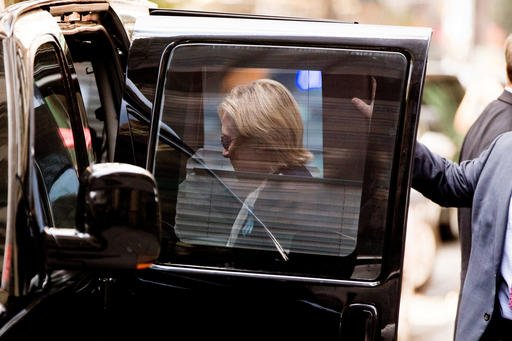 Democratic presidential candidate Hillary Clinton gets into a van as she leaves an apartment building Sunday, Sept. 11, 2016, in New York. Clinton's campaign said the Democratic presidential nominee left the 9/11 anniversary ceremony in New York early aft