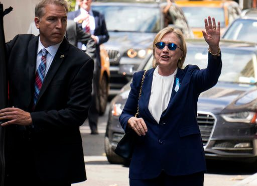 "Democratic presidential candidate Hillary Clinton walks from her daughter's apartment building Sunday, Sept. 11, 2016, in New York. Clinton unexpectedly left Sunday's 9/11 anniversary ceremony in New York after feeling ""overheated,"" according to her campa"