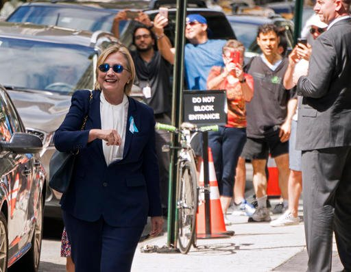 "Democratic presidential candidate Hillary Clinton walks from from her daughter's apartment building Sunday, Sept. 11, 2016, in New York. Clinton unexpectedly left Sunday's 9/11 anniversary ceremony in New York after feeling ""overheated,"" according to her"