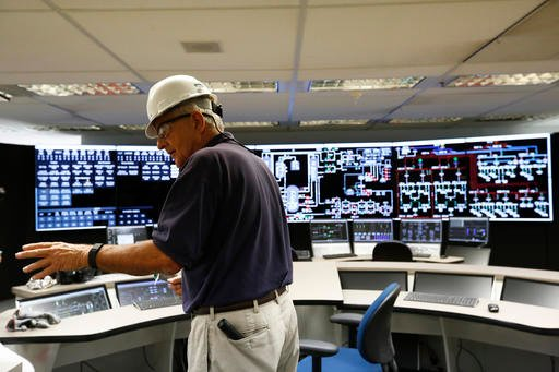 In this Wednesday, Sept. 7, 2016 photo, sit manager, Jim Chardos, shows the media the control room at the Bellefonte Nuclear Plant, in Hollywood, Ala. The sale of the unfinished plant is bittersweet for site manager Chardos, who went to work at Bellefonte