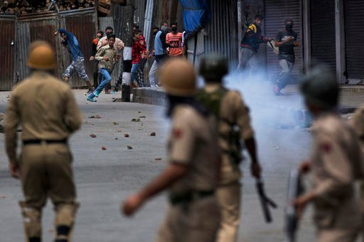In this Aug. 31, 2016, file photo, Kashmiri protesters face Indian policemen in Srinagar, Indian controlled Kashmir. As Kashmir enters a third month of tense conflict marked by violent street clashes and almost daily protests following the July 8, 2016 ki