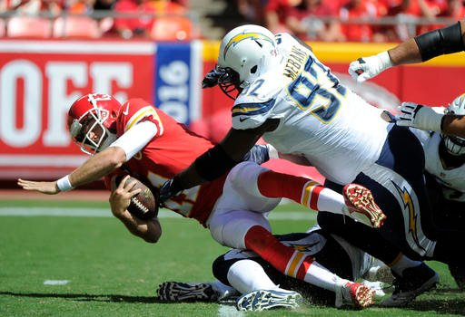 San Diego Chargers linebacker Jeremiah Attaochu (97) sacks Kansas City Chiefs quarterback Alex Smith (11) during the first half of an NFL football game in Kansas City, Mo., Sunday, Sept. 11, 2016. (AP Photo/Ed Zurga)
