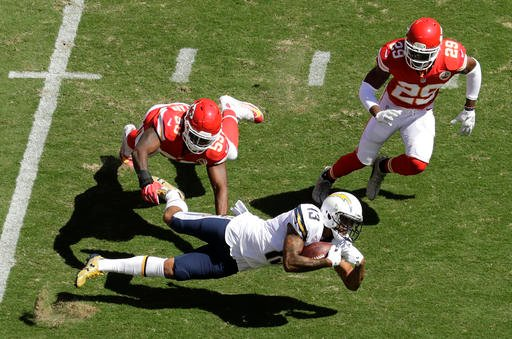 San Diego Chargers wide receiver Keenan Allen (13) makes a catch against Kansas City Chiefs defensive back Eric Berry (29) during the first half of an NFL football game in Kansas City, Mo., Sunday, Sept. 11, 2016. (AP Photo/Charlie Riedel)