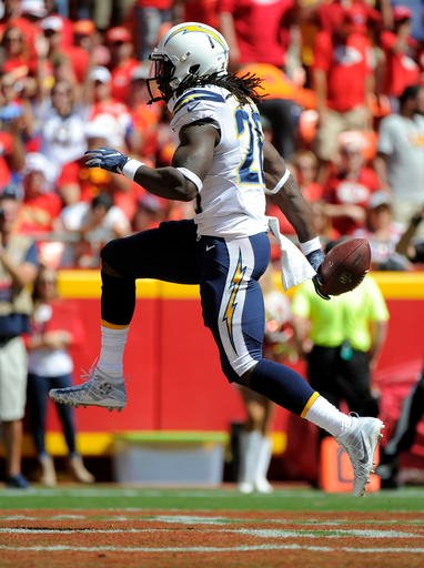 San Diego Chargers running back Melvin Gordon (28) celebrates a touchdown during the first half of an NFL football game against the Kansas City Chiefs in Kansas City, Mo., Sunday, Sept. 11, 2016. (AP Photo/Ed Zurga)