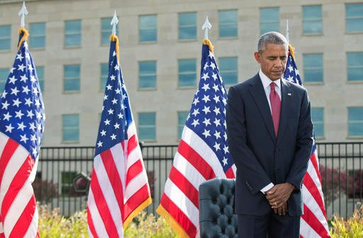 President Barack Obama bows as a moment of silence is observed during a memorial ceremony at the Pentagon in Washington to commemorate the 15th anniversary of the 9/11 terrorist attacks, Sunday, Sept. 11, 2016. (AP Photo/Manuel Balce Ceneta)