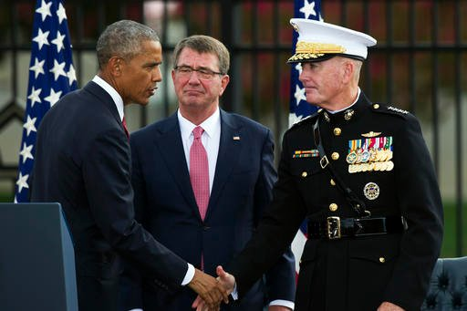 President Barack Obama, left, shakes hands with Chairman of the Joint Chiefs Marine Corps Gen. Joseph Dunford, right, as Secretary of Defense Ashton Carter, center, looks on after delivering remarks at the Sept. 11 memorial observance ceremony at the Pent