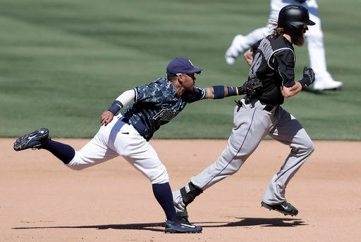 Colorado Rockies' Charlie Blackmon, right, is tagged out by San Diego Padres shortstop Alexi Amarista during the fifth inning of a baseball game, Sunday, Sept. 11, 2016, in San Diego. (AP Photo/Ryan Kang)