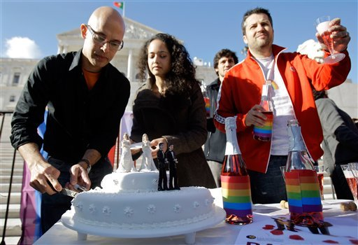 Activists serve wedding cake and champagne outside the Portuguese parliament, Friday, Jan. 8 2010, in Lisbon, after lawmakers passed a bill allowing gay marriage. (AP Photo/Armando Franca)