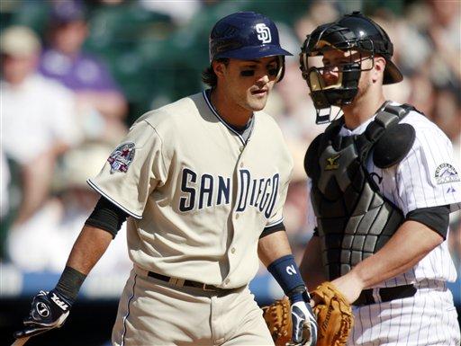 Former San Diego Padres' Edgar Gonzalez, left.