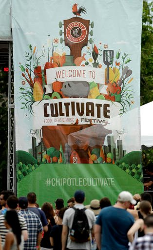 In this Saturday, July 23, 2016, photo, people listen to a band at the Cultivate Festival in Kansas City, Mo. Chipotle's Cultivate festivals encapsulate the food industryâ??s hottest marketing trend: crusading against Big Food. (AP Photo/Charlie Riedel)