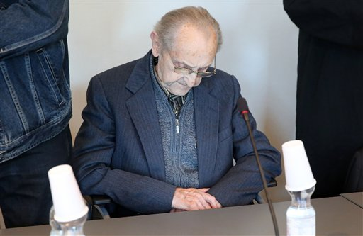 Hubert Zafke sits in a courtroom ahead of his trial in Neubrandenburg, eastern Germany, Monday, Sept. 12, 2016. The former SS medic who served at the Auschwitz death camp has gone on trial in the northern German city of Neubrandenburg, though questions re
