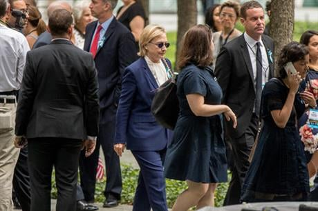 Democratic presidential candidate Hillary Clinton arrives to attend a ceremony at the National September 11 Memorial, in New York, Sunday, Sept. 11, 2016, on the 15th anniversary of the Sept. 11 attacks. (AP Photo/Andrew Harnik)