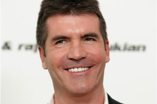 """FILE - In this Feb. 22, 2009 file photo, television personality Simon Cowell poses in West Hollywood, Calif. Cowell said Monday, Jan. 11, 2010 that this will be his last season on """"American Idol."""""""