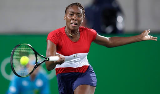 Venus Williams, of the United States, returning against Kirsten Flipkens, of Belarus, at the 2016 Summer Olympics.